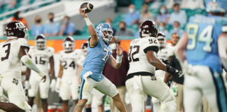 North Carolina Tar Heels quarterback Sam Howell (7) gets off a pass against the Texas A&M Aggies during the second half at Hard Rock Stadium.
