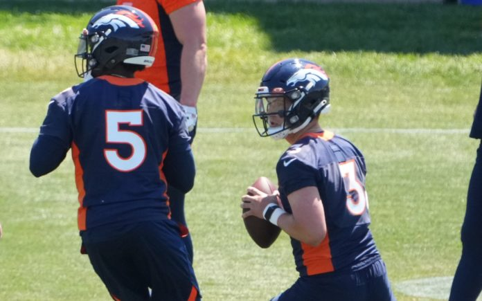 Drew Lock and Teddy Bridgewater in Broncos practices in June. Credit: Ron Chenoy, USA TODAY Sports.