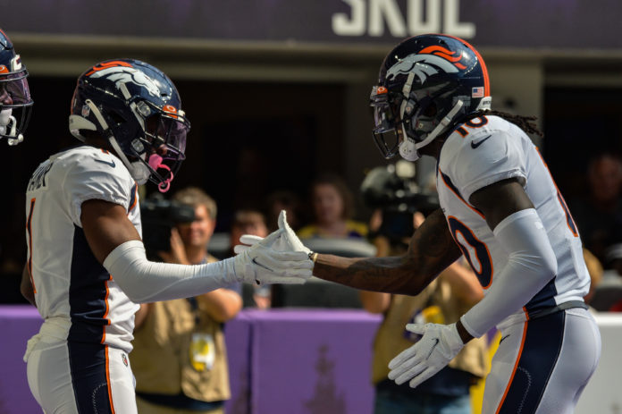 Denver Broncos wide receiver K.J. Hamler (1) and wide receiver Jerry Jeudy (right) react after a touchdown reception by Hamler against the Minnesota Vikings during the first quarter at U.S. Bank Stadium.