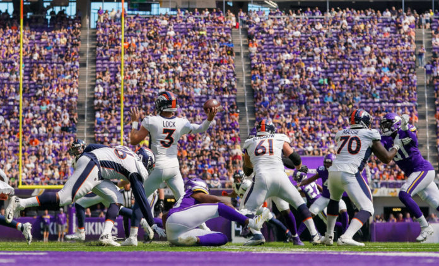 Denver Broncos quarterback Drew Lock (3) passes against the Minnesota Vikings in the first quarter at U.S. Bank Stadium.