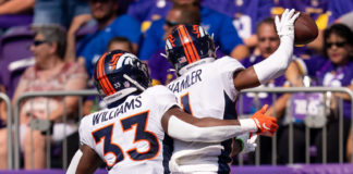 Denver Broncos wide receiver K.J. Hamler (1) celebrates his touchdown with running back Javonte Williams (33) against the Minnesota Vikings in the first quarter at U.S. Bank Stadium.