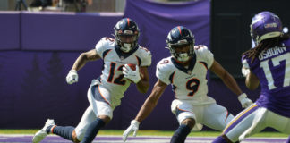 Denver Broncos wide receiver Trinity Benson (12) runs the ball as wide receiver Kendall Hinton (9) goes to block Minnesota Vikings wide receiver K.J. Osborn (17) during the first quarter at U.S. Bank Stadium.