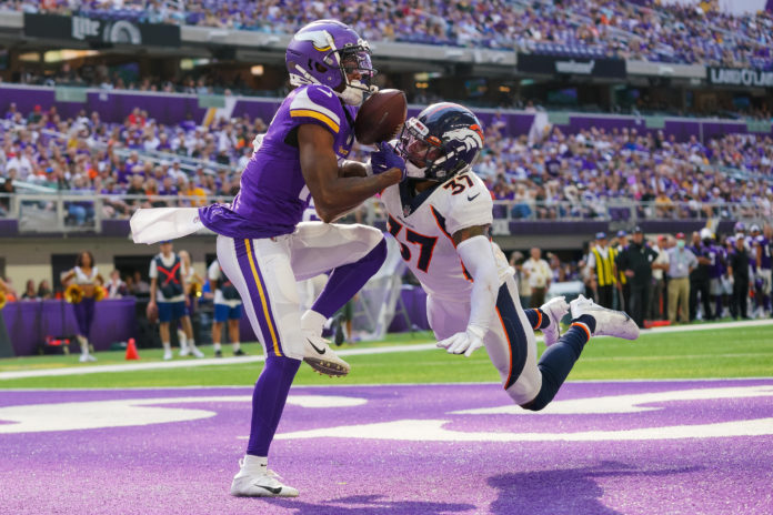 Minnesota Vikings wide receiver Whop Philyor (16) attempts to catch a pass against the Denver Broncos defensive back P.J. Locke (37) in the third quarter at U.S. Bank Stadium.