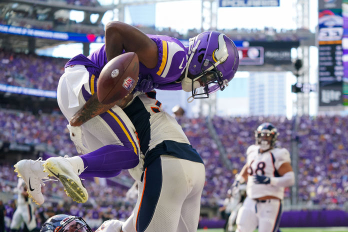 Denver Broncos safety Caden Sterns (30) breaks up a pass to Minnesota Vikings wide receiver Whop Philyor (16) in the third quarter at U.S. Bank Stadium.