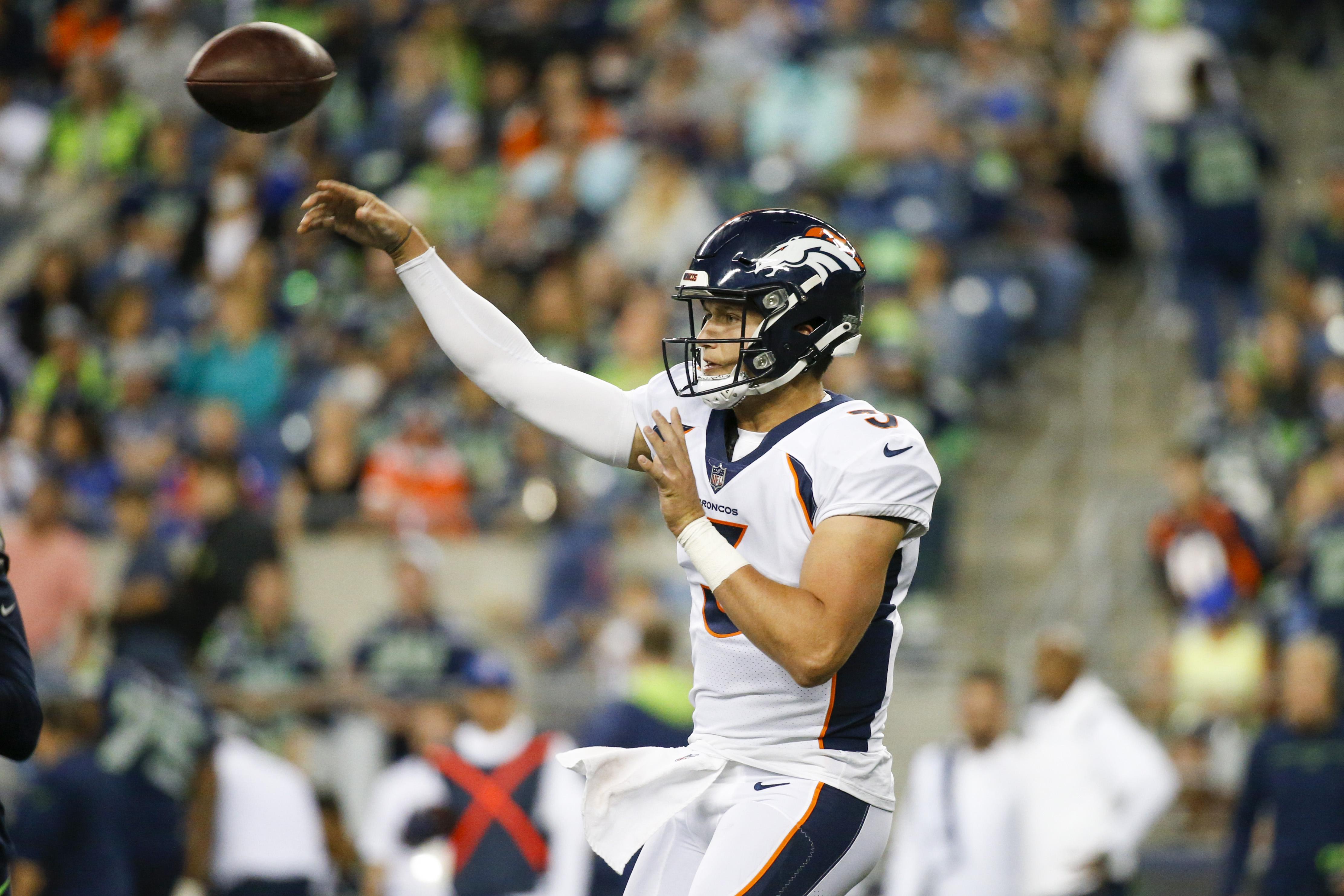 Denver Broncos quarterback Drew Lock (3) passes against the Seattle Seahawks during the second quarter at Lumen Field.