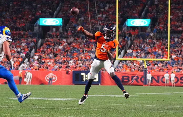 Denver Broncos quarterback Teddy Bridgewater (5) throws a touchdown pass against the Los Angeles Rams in the second quarter during a preseason game at Empower Field at Mile High.