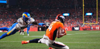 Denver Broncos wide receiver Courtland Sutton (14) pulls in a touchdown against Los Angeles Rams cornerback Robert Rochell (31) in the second quarter of a preseason game at Empower Field at Mile High.