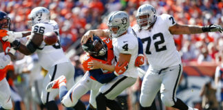 Denver Broncos outside linebacker Von Miller (58) strip sacks Oakland Raiders quarterback Derek Carr (4) as Oakland Raiders offensive tackle Donald Penn (72) defends, but the play would be called back on a defensive penalty in the first quarter at Broncos Stadium at Mile High