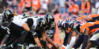 The Jacksonville Jaguars and the Denver Broncos line up for the final play of the fourth quarter at Empower Field at Mile High.