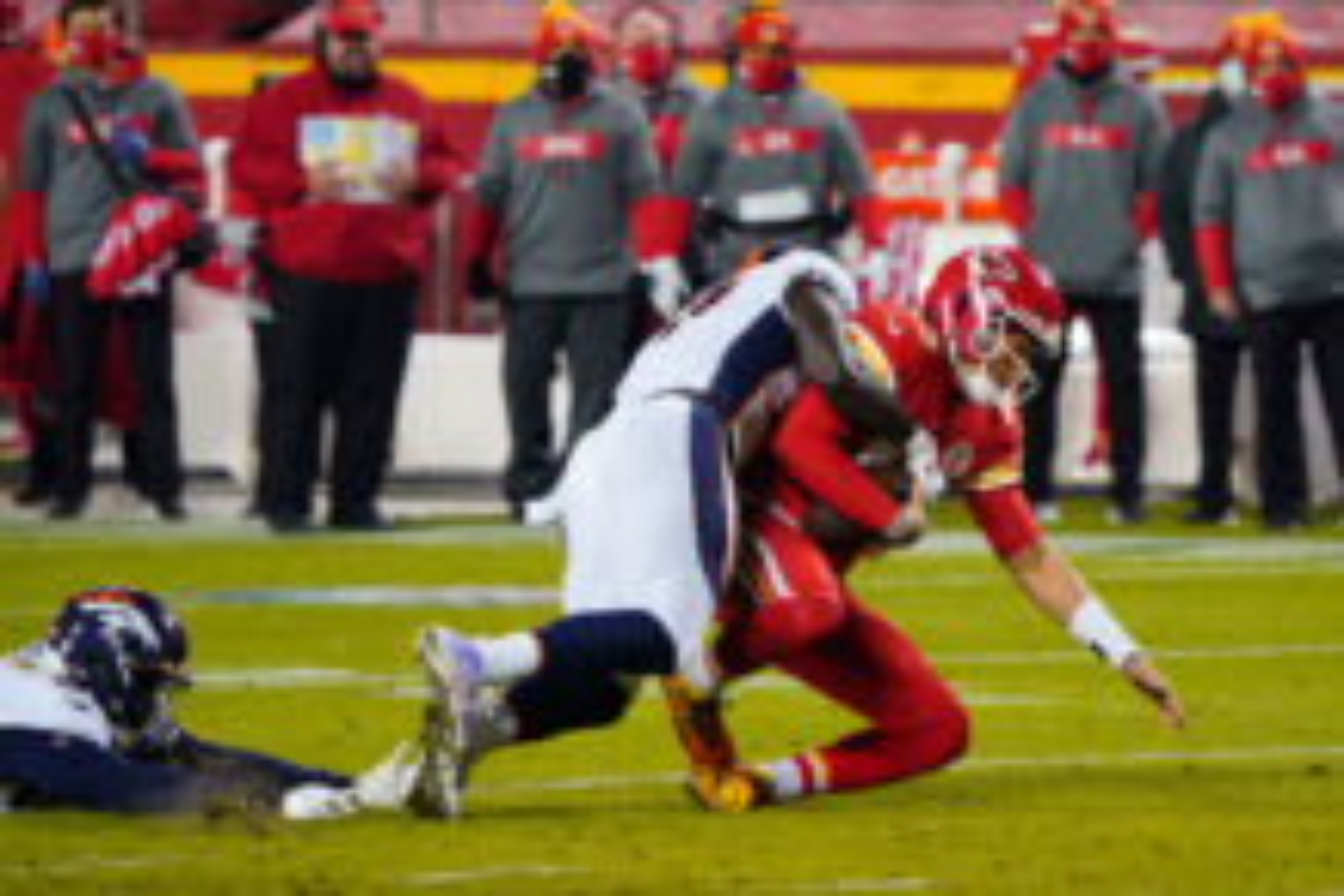 Denver Broncos outside linebacker Jeremiah Attaochu (C) sacks Kansas City Chiefs quarterback Patrick Mahomes (R) during the second half at Arrowhead Stadium.