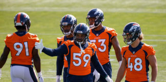 Denver Broncos outside linebacker Malik Reed (59) with Derrek Tuszka (48) and Jonathon Cooper (53) and Patrick Morris (50) and Andre Mintze (91) during training camp at UCHealth Training Center.