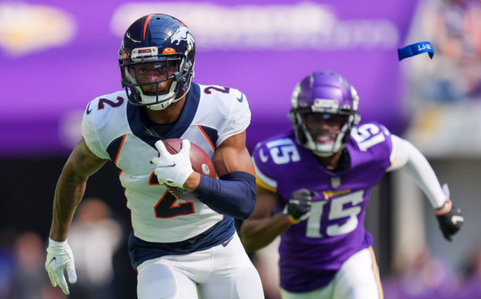 Denver Broncos cornerback Pat Surtain II (2) intercepts the ball for a touchdown against the Minnesota Vikings in the second quarter at U.S. Bank Stadium.