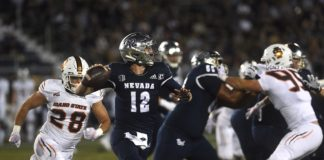 Nevada's Carson Strong looks to throw while taking on Idaho State at Mackay Stadium in Reno on Sept. 11, 2021.
