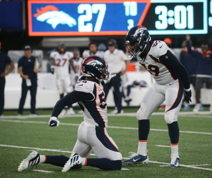 Von Miller of Denver celebrates with Malik Reed in the fourth quarter after they stopped the giants offense as the Denver Broncos came to MetLife Stadium in East Rutherford, NJ and beat the New York Giants 27-13 in the first game of the 2021 season on September 12, 2021.