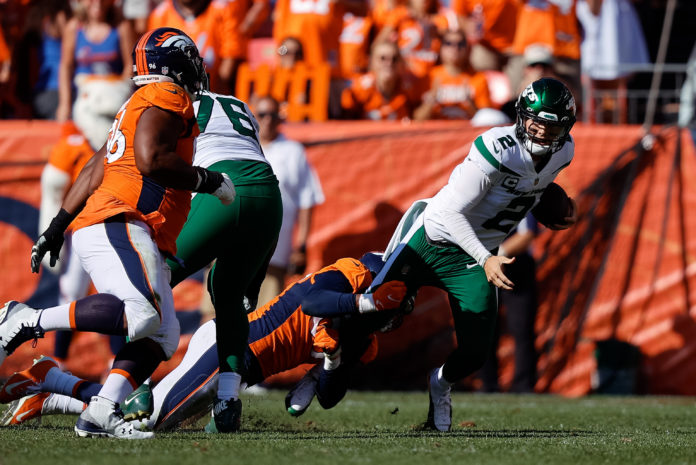 New York Jets quarterback Zach Wilson (2) is sacked by Denver Broncos linebacker Malik Reed (59) in the second quarter at Empower Field at Mile High.