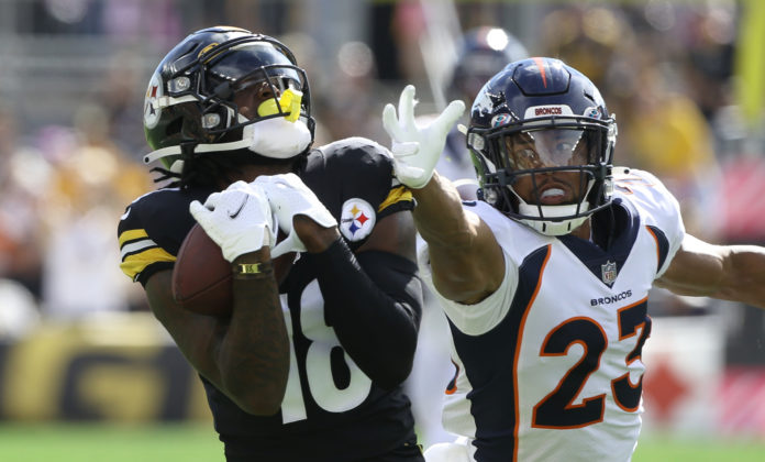 Pittsburgh Steelers wide receiver Diontae Johnson (18) catches a fifty yard touchdown pass behind Denver Broncos cornerback Kyle Fuller (23) during the first quarter at Heinz Field.