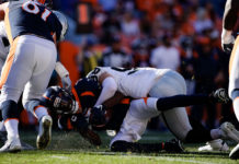 Denver Broncos quarterback Teddy Bridgewater (5) is sacked by Las Vegas Raiders defensive end Maxx Crosby (98) in the second quarter at Empower Field at Mile High.